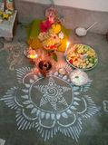 Alpona on the floor in Laxmi Puja with different fruits in India,Alpona drawn by hand. royalty free stock photos