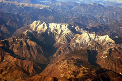 The Alps. Mountains seen from aeroplane window Stock Photo