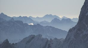 The Alps. Receeding ridges of snow capped mountains Royalty Free Stock Photography