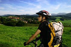In Alps #5. A woman with a bike in Alps /Bavaria / Bergen / Hochfelln Stock Photos