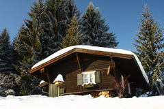 In The Alps. Traditional house in the snowy winter landscape of the Alps Royalty Free Stock Images