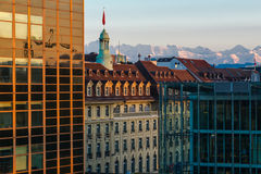 Alps above city Stock Images