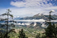 Alps above the clouds. Near Sion in Valais Canton in Switzerland royalty free stock photos