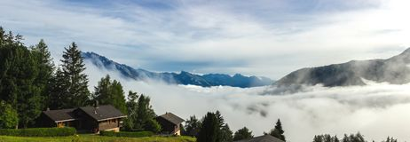 Alps above the clouds. Near Sion in Valais Canton in Switzerland stock images