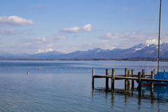 Alps across Bavarian lake. Alps in background across lake in Bavaria, Germany Royalty Free Stock Photo