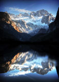 Alps in Austria with mountain lake reflection Stock Photography