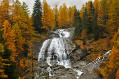 Alps autumn landscape and waterfall. Autumn landscape and waterfall in Italy Alps area Royalty Free Stock Photo
