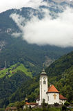 Alps church mountains Switzerland Stock Photography