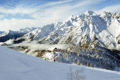 Alps and cottage Stock Images