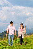 Alps - Couple hiking in Bavarian mountains Royalty Free Stock Photography