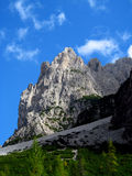 Alps. Dolomite Alps mountain rocky scenery. Beautiful rocky peaks, mountain and gray stones on a sunny day, deep blue sky with some clouds. Beautiful mountain Royalty Free Stock Photography