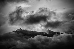 The Alps. Dramatic black and white photo of a hill in the Alps Royalty Free Stock Photos