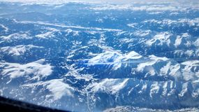 Alps. Flying over the Alps stock images
