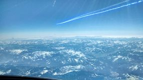 Alps. Flying over the Alps stock photo