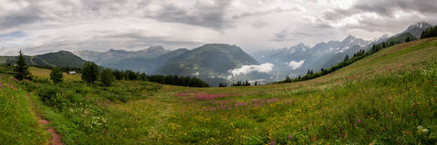 Alps, France (Col de Voza) - Panorama. View of the Savoy Alps near the mountain-saddle called Col de Voza in France - hiking on tour of Mont Blanc Stock Photos