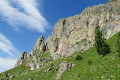 Alps green hills and rocky mountain peaks Royalty Free Stock Photo