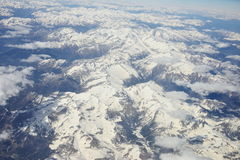 Alps from the height of 9000 meters. View of the Alps out the window of the plane. Filmed in June of 2015 royalty free stock photography