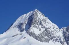 Alps. High snowy peak in the Alps Stock Photo