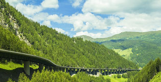 Alps and high-speed road in the mountains Royalty Free Stock Images