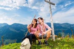Alps - Hiking Couple takes break in mountains Stock Image