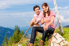 Alps - Hiking Couple takes break in mountains Royalty Free Stock Photography
