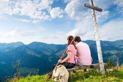 Alps - Hiking Couple takes break in mountains Royalty Free Stock Photo