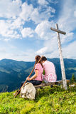 Alps - Hiking Couple takes break in mountains Royalty Free Stock Images