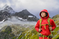 Alps Hiking - hiker woman in Switzerland mountains. Alps Hiking - Asian hiker woman in Switzerland on trek in mountains with backpack living a healthy active Royalty Free Stock Photos