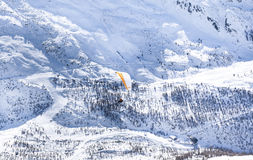 Alps hills with orange parachute Royalty Free Stock Image