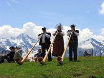 Alps horn in Folk festival mannlichen Stock Photos