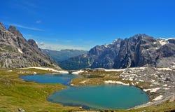 Alps, lakes in the mountains Stock Photos