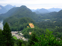 Alps landscape with Hohenschwangau castle. Hohenschwangau castle is the pearl of german romantic. Sactle was built in 12th century by knights Stock Images