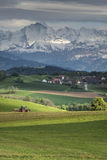 Alps landscape with a village in front of it Royalty Free Stock Image