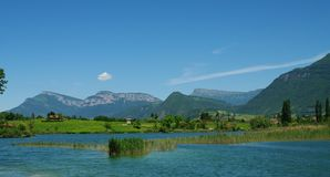 Alps landscapes. Lake vineyard and mountain in french alps in spring Stock Photo
