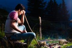 Alps - Man at campfire in Bavarian mountains Stock Photos
