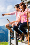 Alps - Man and woman sitting at cabin in tirol Royalty Free Stock Photo