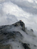 Alps with mist and cable car. Cables descend into fog with Alps in background Stock Image