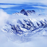 Alps mountain with clouds, Switzerland. Stock Image
