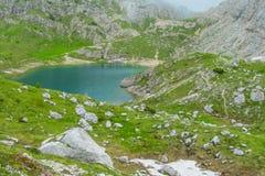 Alps mountain green valley and lake landscape Stock Photos