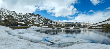 Alps mountain lake (spring panorama). Royalty Free Stock Photos