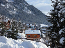 Alps, mountain range covered in the snow, alpine village. Stock Images