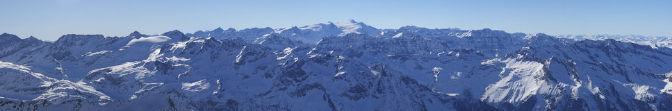 Alps mountain winter panorama in austria. Alps mountain winter snow and ice panorama in austria high peaks from kitzsteinhorn peak including grossglockner the Stock Image