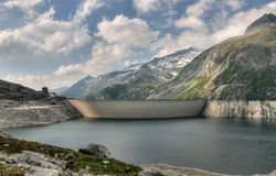 Alps mountains and dam wall Stock Images