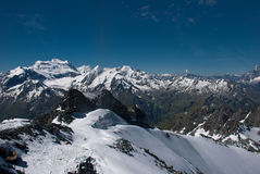 The Alps Mountains - Between Ice and Snow. The Alps are one of the great mountain range systems of Europe stretching approximately 1,200 kilometres (750 mi) Stock Photos