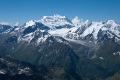 The Alps Mountains - Between Ice and Snow. The Alps are one of the great mountain range systems of Europe stretching approximately 1,200 kilometres (750 mi) Stock Images