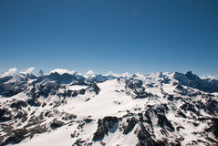 The Alps Mountains - Between Ice and Snow. The Alps are one of the great mountain range systems of Europe stretching approximately 1,200 kilometres (750 mi) Stock Photography