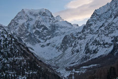 The Alps Mountains - Between Ice and Snow. The Alps are one of the great mountain range systems of Europe stretching approximately 1,200 kilometres (750 mi) Royalty Free Stock Photo