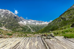 Alps mountains from an old wood bridge Stock Photography