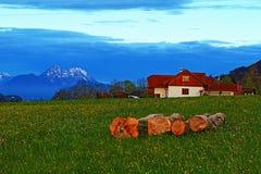 Alps mountains spring farmhouse Royalty Free Stock Photo