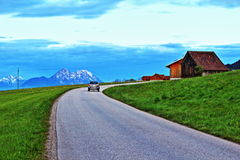 Alps mountains spring road Stock Photography